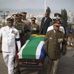 RT @justteaplease: Nelson Mandelas coffin carried into amphitheater of Union Buildings. Moving moment #Mandela http://t.co/pVjMQfBYLd