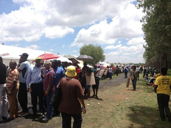 RT @BBCRosAtkins: Long queues of people using cardboard for shade. Waiting for Mandela buses to take them to Union Buildings. #BBCOS http://t.co/8vEiqNbsqO