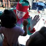 Luv! RT @SingSaraswati: Elves descend down the outside of @LeBonheurChild spreading holiday cheer. @memphisnews http://t.co/S3BMcLghHD