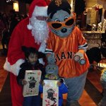 Lou Seal & Santa welcome kids to the #SFGiants annual holiday party for families from our local homeless shelters http://t.co/I6vJaUdhBM