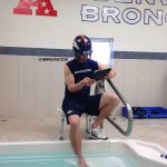 Helmet on. Gametape on iPad. Ankle soaking.  This is how Peyton Manning spends his downtime. http://t.co/rm27Rwgoa7