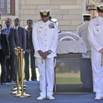 PHOTO: Rwandan President Paul Kagame bows before #Mandelas glass coffin at the Union Buildings in Pretoria, SA. http://t.co/Y0NEMG8TKL