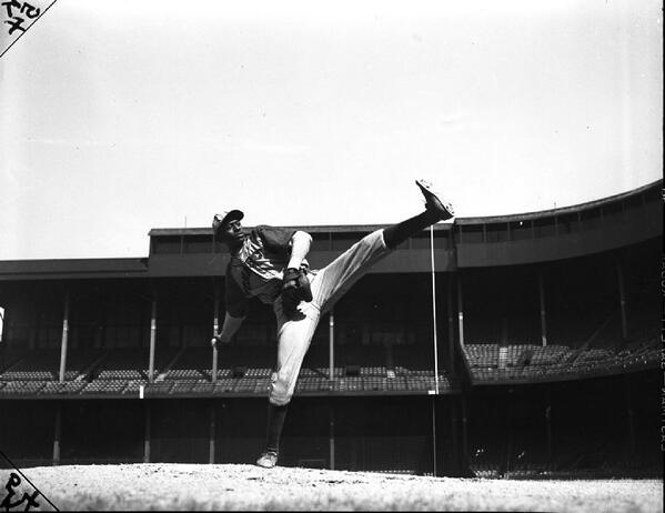 Satchel Paige, with the Negro League's KC Monarchs, shows off his high leg kick at Tiger Stadium c. 1945. @nlbmprez http://t.co/5mKg1nlj4v