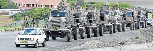 RT @Dispatch_DD: #Military trucks line up on the N2 near #Madiba 's #Qunu home as they prepare to move out. http://t.co/tFrNEhv5DM