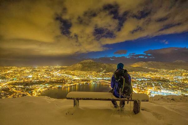 A hiker enjoys a snowy winter evening in Bergen, Norway http://t.co/o1NmvsZ7Qp