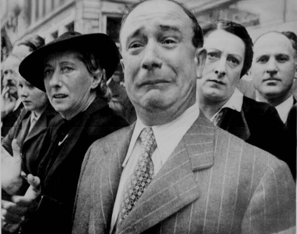 A French civilian cries in despair as Nazis occupy Paris during World War II. http://t.co/7LXXeyQZNk