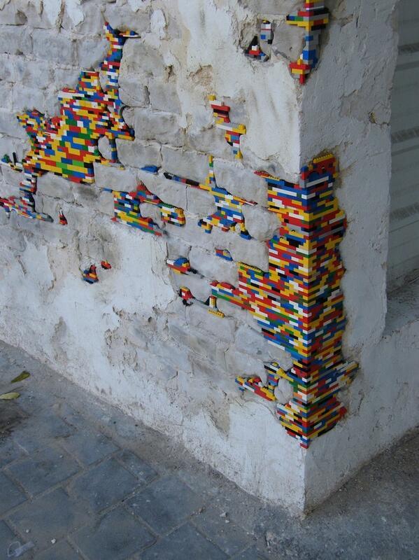 very cool RT @reThink_Israel: German artist Jan Vormann travels the world repairing cracks with legos. http://t.co/ApZU5mkv4M