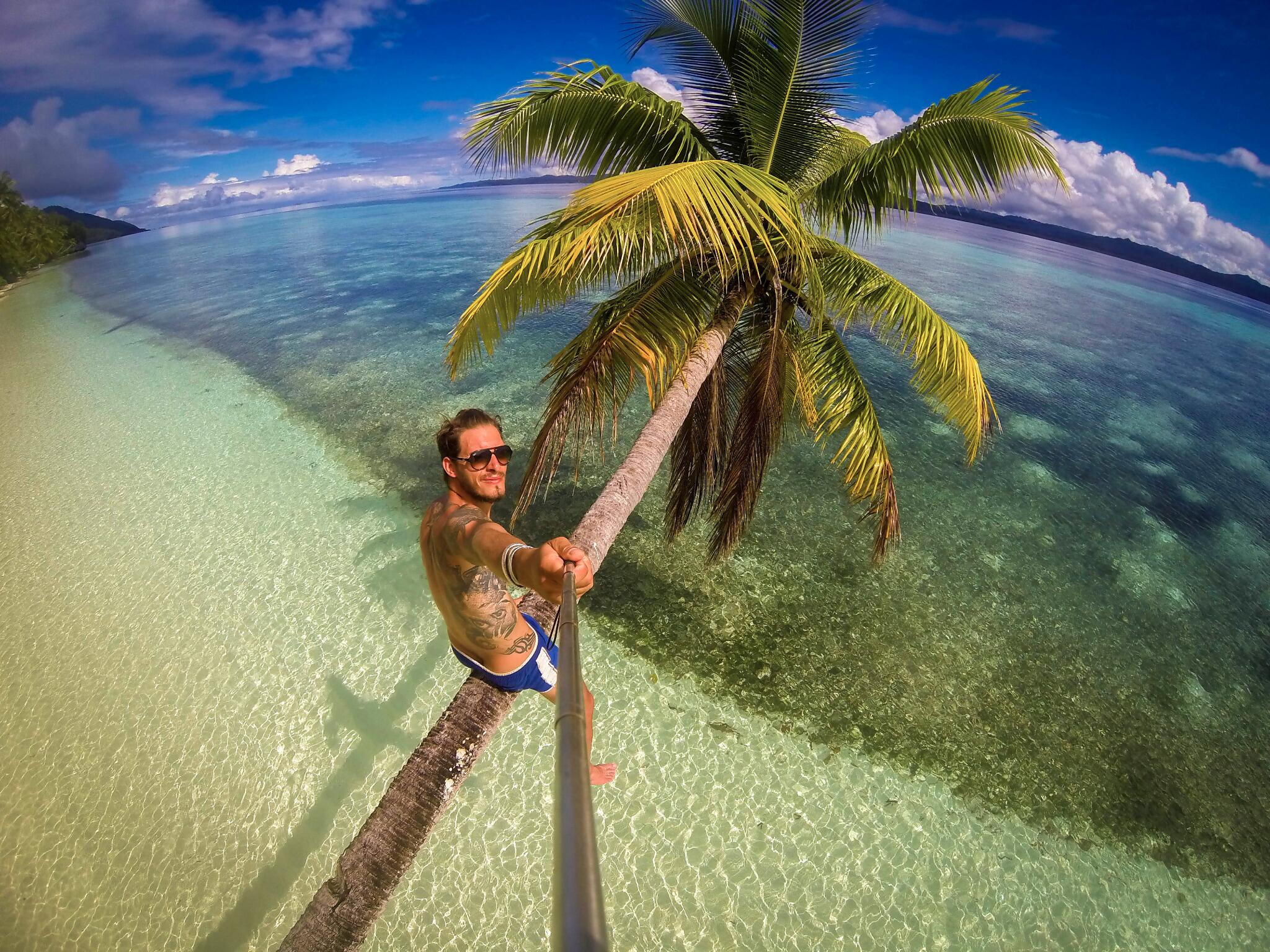 Photo of the Day! Climbing a coconut tree in Indonesia for the morning beverage. Photo by Loic Bonin. #GoPro #Travel http://t.co/Xf7iMUgT71