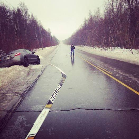 Waiting for the tow truck, might as well pass the puck around on the icy road. http://t.co/UQpPnqmrlP