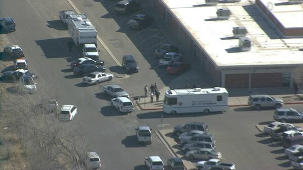 Kim Tobin (@kimtobinkob): The view from Chopper 4 above #roswell middle school-- lots of police on scene. Shooting suspect in custody. http://t.co/zf2OHpvo3N