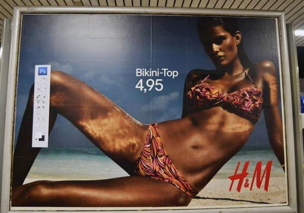 Brilliant - A German artist has pasted Photoshop controls on several H&M Billboards (via @reddit): http://t.co/RrukotL4kx