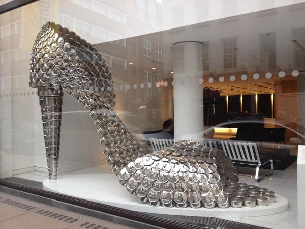 Selfridges window this afternoon - looking closely you will see it's made of saucepans http://t.co/AagUVW3sOt
