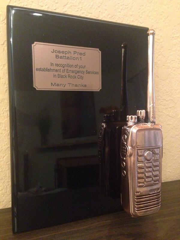 My retirement plaque from Burning Man. Yes, that's a real bronzed Motorola radio. Thank You to all my peers. http://t.co/h3whbh93NG