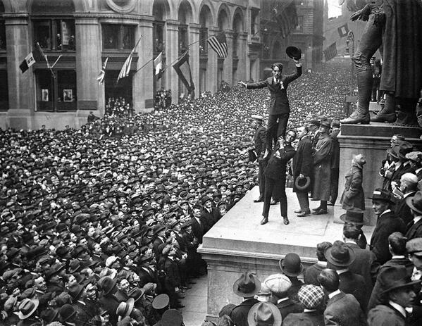 Charlie Chaplin being held in the air by Douglas Fairbanks, 1918 http://t.co/C8ToKKdmw6
