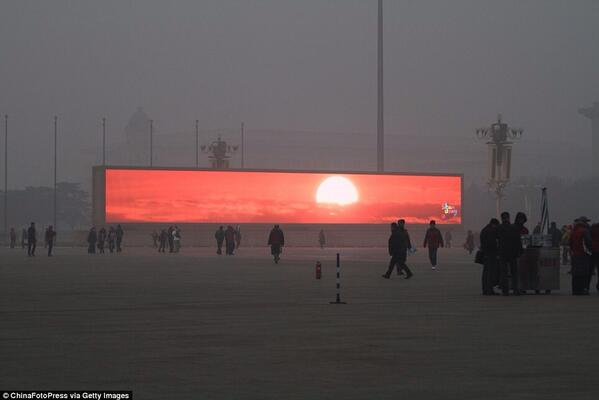 Your Daily Dystopia: LED screen shows the rising sun in Tiananmen Square amid heavy smog http://t.co/SCbHLJD7RG (via @GBoddington)