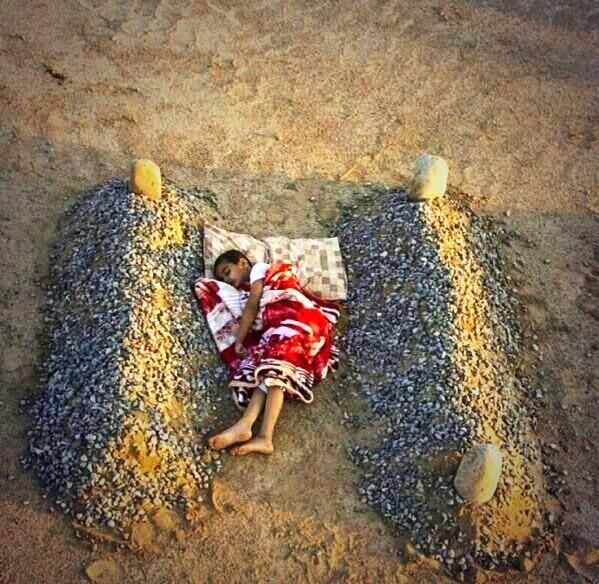 """""""@Powerful_Pics: A boy in #Syria sleeping next to his mother and father... http://t.co/FGrTpYrMPx"""" .."""