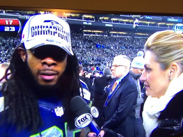 Hey @erinandrews why was Busta Rhymes so mad? #WooHaa #nfl #foxsports #seahawks http://t.co/3Ir21fKC4j