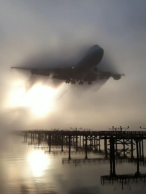 Fog creates challenges for airport ops, also creates photo ops. 747 bursting through fog @flySFO Touch n Go Photo: http://t.co/JTuJJguYlT