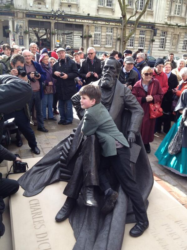 Oliver Dickens with the statue of his great great great grandfather unveiled in Portsmouth today. http://t.co/dQh47bhSB9
