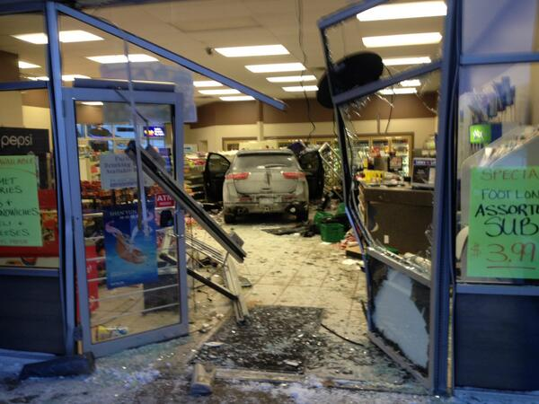 A car has crashed into a convenience store near SJAM in Waterloo.  Not just the front window, INTO the store. http://t.co/sioLmqpa9O