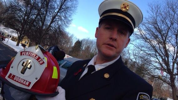 Penfield fire chief ebmeyer holds honorary helmet to be given to Tyler Doohan's family at funeral http://t.co/HHzS4mhUkO