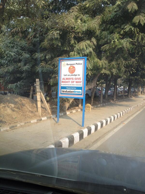 'Road-safety' signs 'supported by' @htTweets all over Gurgaon. Reposition them so people can use footpaths. Pls RT. http://t.co/EW5h7n2yUM