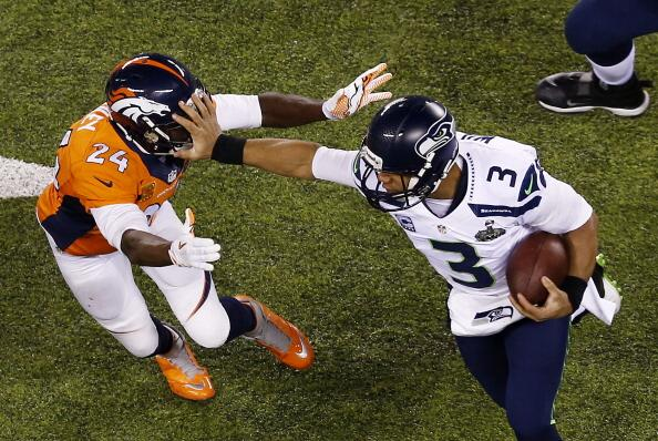 Wow!  RT @JasonRomano: This stiff-arm picture of Russell Wilson is AWESOME!! http://t.co/I3Ncetlx7G