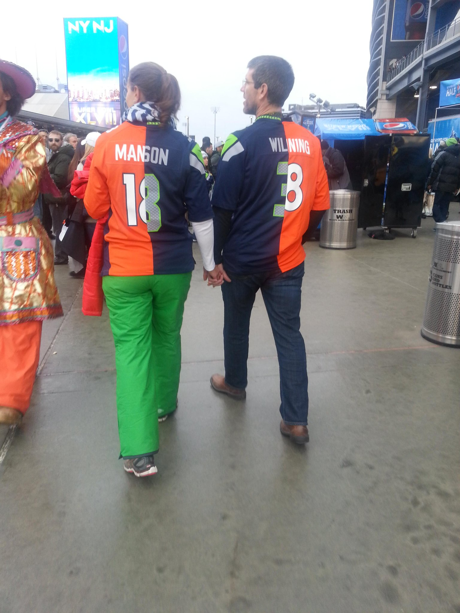 Is that a Charles Manson jersey? RT @SNFonNBC: This couple is rooting for Russell Wilson and Peyton Manning, equally: http://t.co/YujAt4ScIB