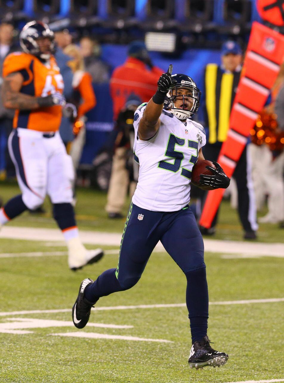 Seattle's defense is setting the tempo of Super Bowl XLVIII -- and this Malcolm Smith pick-six proved it: http://t.co/7waLgZIeT4