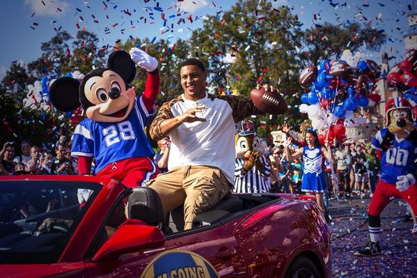 Malcolm Smith @MalcSmitty parades w. Mickey Mouse through the Magic Kingdom @WaltDisneyWorld.  http://t.co/Wd6kfK6eZF http://t.co/yVpFbIMVTx