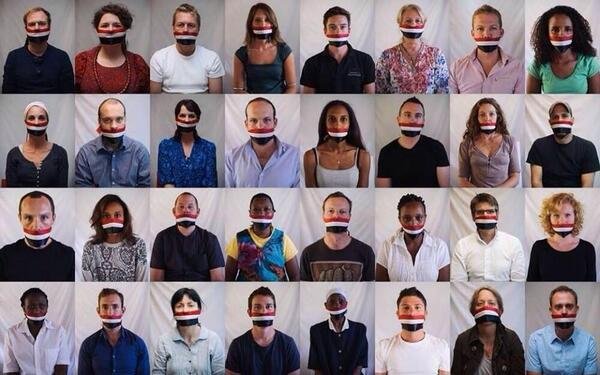 Journalists across the world have posed with their mouths taped in solidarity with journalists detained in #Egypt http://t.co/j0EQTVyjXI