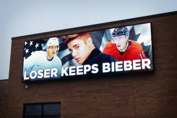 """@DNAinfoCHI: ""Loser Keeps Bieber"" billboard pops up ahead of USA vs Canada hockey semifinal http://t.co/wyhZjUaFwm"""