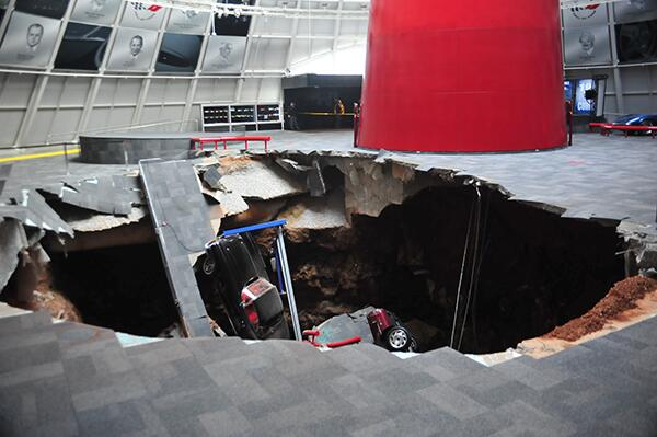 Holy Cow. RT @Justin_Hyde: First photo from the Corvette Museum of the sinkhole with eight rare Vettes inside: http://t.co/9WshK3w1SI