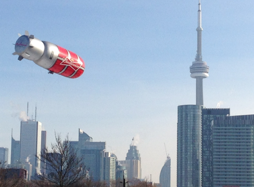 If you're in #Toronto and watching the game look out your window. @BudRedLights is flying over the city. #sochi http://t.co/8aBsVExqhv