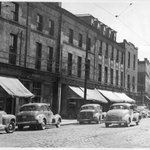 Water Street with cars driving on the left side of the road, c. 1940s. #yyt #newfoundland #nlhistory http://t.co/xxsJgyKDPN