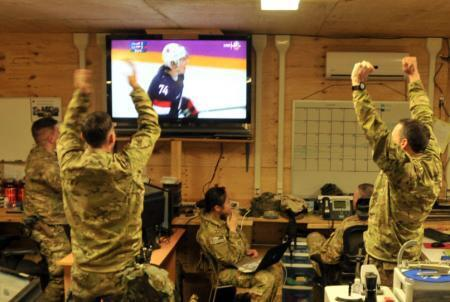 U.S. Army in Afghanistan celebrating win over Russia today. Very cool moment captured http://t.co/4avetB1PAa (via @penguins)