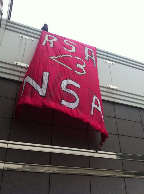"""Activists drop """"RSA <3 NSA"""" banner at security conference ejected off property by #RSAC http://t.co/5QC1bMgiy4"""
