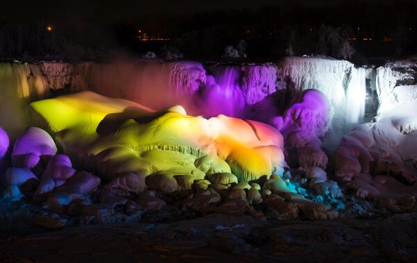 Niagara Falls, frozen over and bathed in neon lights: http://t.co/dz9M3fAgUA  http://t.co/tNg29Hq3qv