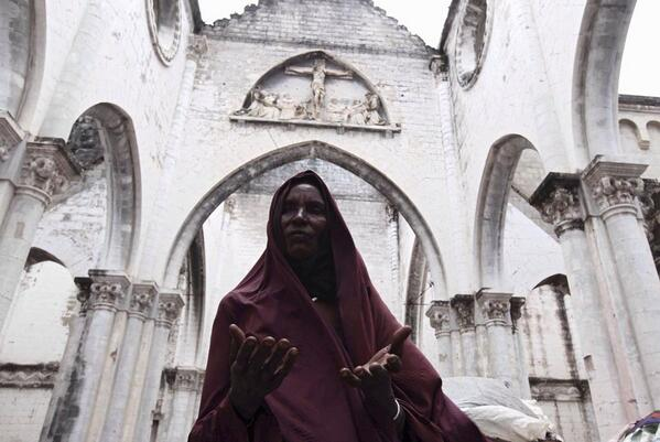My fav pic from #Somalia is of this IDP woman praying in a crumbling cathedral in #Mogadishu | left me awed http://t.co/hO6FrDftKE