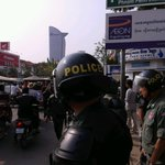 Riot cop on Monivong, Vattanac tower in background, blocked protestors behind him http://t.co/AvA005nG7F