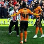 A Walsall fan confronts Wolves player Dicko as he celebrates at the game today. http://t.co/SlOVjMjDzT