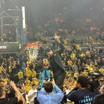 RT @ChantelJennings: A suited up Mitch McGary cuts down the nets. http://t.co/DLtYAkHnPt