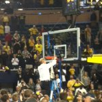 Coach Beilein cutting down the Crisler nets! #GoBlue #B1GChamps http://t.co/Z2UM2n6CnI