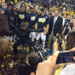 "Charles Woodson yells ""PHOTO BOMB!"" slides right into the middle of Michigan team picture. http://t.co/2MXEPDfiZ2"