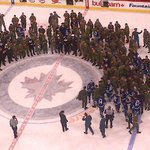 Nice scene post-game as all the #NHLJets have joined the military members in attendance on the ice for a photo-op. http://t.co/gJRklGss18
