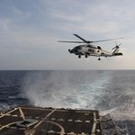 #USNavy SH-60R Seahawk departs to aid in the search efforts of the missing airliner. #MH370 #MalaysiaAirlines http://t.co/7VSNi8xLSi