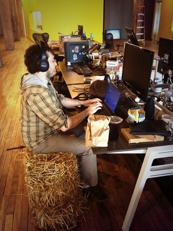 Proof we may have the most hipster office in Boston: @tbranyen working on a straw bale. http://t.co/lTFPDDapEz