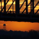 A cyclist crosses the Purple People Bridge from Newport, Ky. to #Cincinnati. #cincylove #cincywx #sunrise http://t.co/nXIKjCZ8vk