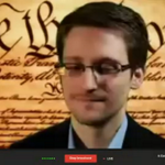 Loud applause as #Snowden appears via satellite video, through 7 proxies! #AskSnowden! http://t.co/y0fNa5CS7F http://t.co/xSttrYsbdH #SXSW