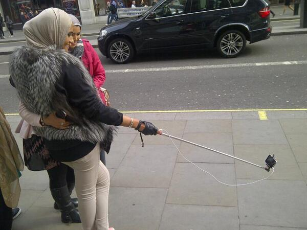 OMG !!! The world's gone mad. The self extension stick . This is for real I took the photo just now in London. http://t.co/0xOR3cyvVa